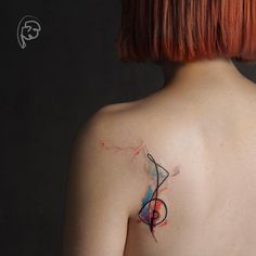 Abstract watercolor tattoo on back shoulder by Tayfun Bezgin