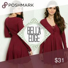 Burgundy lace up ribbed skater dress 95% COTTON, 5% SPANDEX ⚬This adorable dress features a burgundy ribbed fabric, a lace up v-neckline, long sleeves, scalloped trim from neck to under-bust and a skater style skirt. Size small to large Bella Edge Dresses Long Sleeve