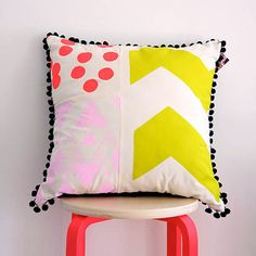 Cushion:  Screen printed bright colours with pom poms - Colourway 2. $72.00, via Etsy.