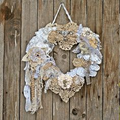 A shabby chic heart shaped wedding wreath made of vintage handmade doilies and laces. It's perfect for wedding decoration or gift and of course for as Valentine's day decoration and gift