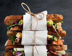 This savory #sandwich is made with brie, prosciutto, caramelized onions, and arugula. Not to mention it's stacked with flavor. #artofcheese #presidentcheese