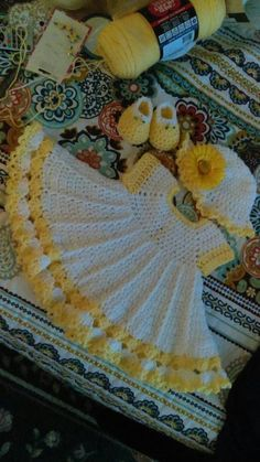 Gorgeous crochet baby dress set in yellow and white.