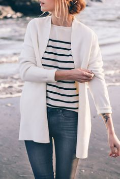 Cute sweater paired perfectly with a striped shirt.