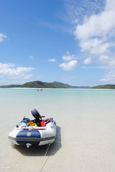 The anchored tender on Hill Inlet, part of Whitehaven Beach in the Whitsundays, Queensland, Australia.