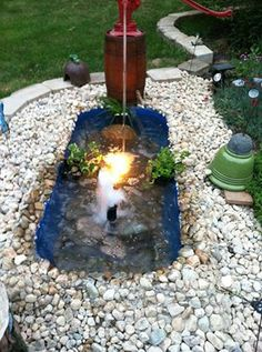 a tub pond...that's one way to repurpose an old bath tub!