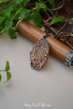 Brown Agate Slice Wire Wrapped Pendant This beautiful brown agate slice is elegantly decorated with copper swirls and beads to create a romantic bohemian style pendant. The natural tones of this pendant will pair perfectly with so many different outfits! *This pendant is