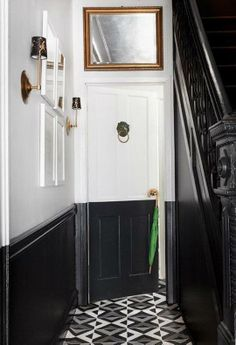 A DIY painted floor canvas that mimics the gorgeous black and white patterned floor tile trend