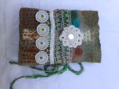 Inside Out fabric journal - eucalyptus dyed wool felt, embroidery stitched, crochet medallion, eucalyptus and rust dyed watercolor paper