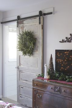 Love this old door hung as a barn door.  This would be an easy DIY project.