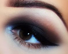 I love how this is only a smokey eye on the top, then they have the brightening highlight on the bottom, combined w/ a severe cateye! Ugh!