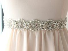 Crystal Bridal Sash with Pearls An ultrafemme crystal bridal sash with pearls and crystalline rhinestones. This crystal bridal sash perfectly blends pearls and rhinestones to create a dazzling crystal floral design. Wedding Dress Sash, Wedding Belts, Bridal Sash, Wedding Jewelry, Wedding Dresses, Bridal Belts, Bridal Accessories, Fashion Accessories, Groom And Groomsmen Suits