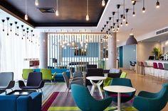 Holiday Inn Express Aberdeen | Lounge Bar Design | Holiday Inn Express Aberdeen | Fishing Boat Rope Screen Divider | Polished Concrete Column | Feature Lighting: