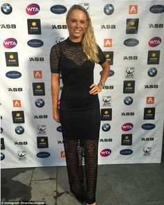 Caroline Wozniacki poses for a media event shortly after landing in Auckland ahead of the Australian Open