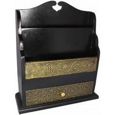 Organize your mails, coupons, and magazines in style when you choose this contemporary mango wood black mail organizer with hand hammered brass fitting. http://www.worldhomedecor.com/home-accents/mail-organizers/contemporary-solid-wood-brass-fitting-mail-organizer-black.html
