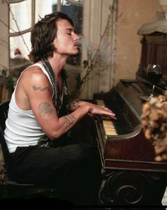 wow!! even with cig smoke and white tank, still the most beautiful man on the earth!
