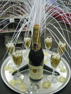 Bottle is Milk Chocolate, glasses are filled with chocolate sixlets and topped with Jelly Belly Champagne Bubbles. Feather Centerpieces, Bottle Centerpieces, Chocolate Centerpieces, Centrepieces, 65th Birthday, Birthday Celebration, Deco Ballon, Great Gatsby Theme, Diamond Party