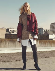 The Model wears Bomber Jacket, Knit Tunic, Long Cotton Shirt, Straight Ankle Jeans and Patent-Leather Boots for 2016 lookbook