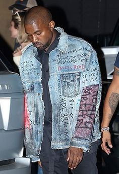 Kanye West in graffitied, illustrated and customised denim jacket