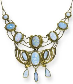 AN ART NOUVEAU OPAL NECKLACE   Composed of a series of graduated opal shield-shaped plaques, joined by three-row gold oval link chains, suspending an openwork foliate and scrollwork motif plaque set with three oval opals, suspending three opal drops, from a fine oval link backchain, with opal clasp, mounted in gold, circa 1890, 137/8 ins.