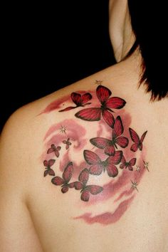 Shoulder tattoo...Personally I would like it with greens blues and purples and actually across the shoulder covering the front and back and part of the arm!
