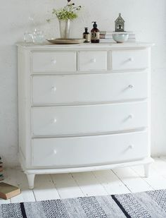 CHALKER CHEST OF DRAWERS. This off-white painted chest of drawers looks just as good in a cool, calm bedroom as it does in a stripey blue beach hut! Dressing Table With Drawers, Dressing Tables, Painted Floorboards, White Chest Of Drawers, Bedroom Cushions, Off White Paints, Comfy Sofa, Furniture Decor, Painted Furniture