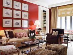 red living room with neutral sofa by Ashley Whittaker