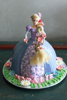 Rapunzel Doll Cake. My going on 6yo has requested this birthday cake, she has more faith in me than I have  : /    this gorgeous cake was created by joyliciouscakes