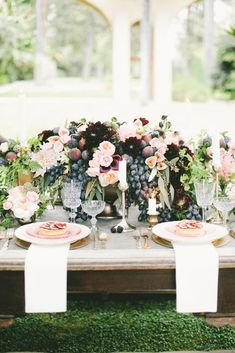 Overflowing floral arrangements filled with fruit! | #wedding #centerpiece | via Domaine Home