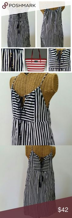 """J Crew nautical comfy dress tassle XS Adorable dress by J Crew Sz XS Cotton...lightweight cool & comfy Navy white stripe Ties at neckline with tassle Underarm to underarm 16.5"""" unstretched  Waist 30""""...meant to fit loosely Top of shoulder to hem 31"""" Excellent condition J. Crew Dresses"""