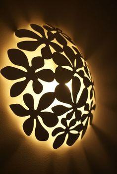 Wall sconce using the Ikea Stockholm fruit bowl. Nifty idea. http://www.ikeahackers.net/2011/03/ikea-fruitbowl-lamp.html