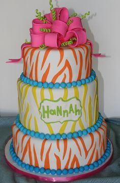 Zebra stripe cake in bright colors with a fondant bow