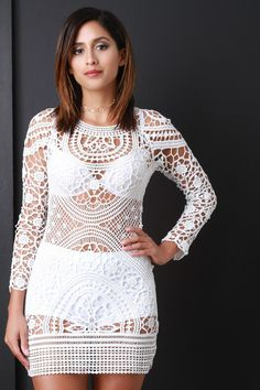 This beautiful dress features a semi-sheer crochet lace design, round neckline, scoop back with a self-tie closure, long scallop sleeves, and mini length hemline. Accessories sold separately. 30% Cotton, 70% Polyester.