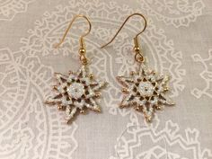 A personal favorite from my Etsy shop https://www.etsy.com/listing/253475948/snowflake-with-gold-tone-wire-hooks