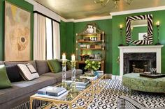 Green Walls In a Living Room With Black and White Details. Design by Sherrill Canet