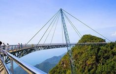Langkawi Sky Bridge Wow, check out this awesome bridge in Malaysia. This bridge is really unique because it is a curved suspension bridge. This is a pedestrian only bridge, so you have to hike it to. Sky Bridge, Pedestrian Bridge, High Bridge, Putrajaya, Kuala Lumpur, Places Around The World, Around The Worlds, Pictures Of Bridges, Scary Bridges