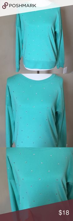Teal sweatshirt with rhinestones Very pretty teal sweatshirt. All rhinestones are intact. Only worn a couple of times, like new. Small ink mark above rhinestone shown in last picture. Barely noticeable. Reflected in price. Smoke free home. Forever 21 Tops Sweatshirts & Hoodies
