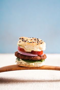 Milanesa - Chicken milanesa sandwich with tomato, totsoi and aioli on a sesame seeded bread amuse gueule