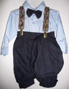 Some slacks headed in this direction I think.  Suspenders are kind of cool, so is the hat.  Shirt and tie meh.