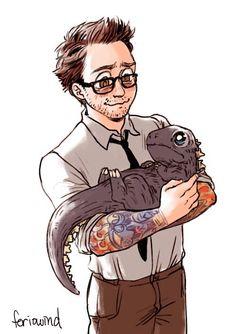 Dr. Newt Geiszler (Pacific Rim) holding a baby Godzilla. Daaaaaaaaawwwww cuteness overload!