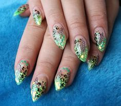 Gel nails with green glitter and leopard design.