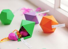 DIY Geometric Favor Boxes. These incredible geometric faceted favor boxes (polyhedron) are perfect for a display table or for use as place cards at each guest's seat.