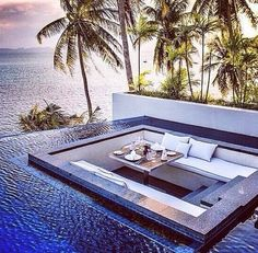 This is an unbelievable space for entertaining in your outdoor living space with a pool #wildandwolf