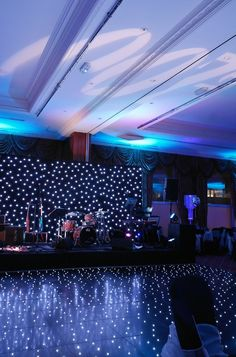Radisson Edwardian Heathrow - Starcloth backdrop, black starlit dance floor, wall uplighters in ice blue and themed gobo projection by www.stressfreehire.com #venuetransformers