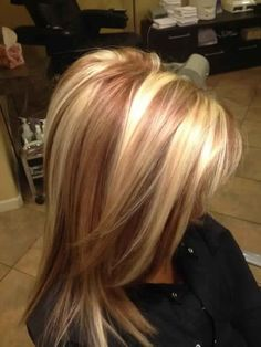 golden blonde hair with red lowlights