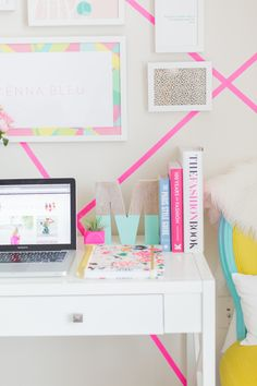 The hot pink tape installation and gallery wall combo is amaze in this home office |  Photography: Stacy Bauer http://www.stacybauerphotography.com/ | Design and Styling McKenna Bleu http://mckennableu.com/