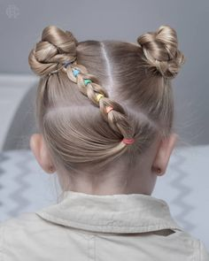Super cute style today!!! little pull through braid at the back into two cute little braided buns and she has a lace braid at the front…