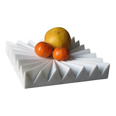 The spines of this fruit tray allow air circulate around fruit, extending its freshness. This tray is hand-carved by traditional stone artisans in Rajasthan State, India.