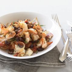 For shrimp saganaki, Greeks sauté shrimp in a pan with tomatoes, olives and feta cheese, then serve it right out of the skillet with bread to soak up...