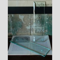 A bevelled edge clear glass pushplate