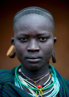 Ethiopia. Surma (Suri) woman face with scarifications